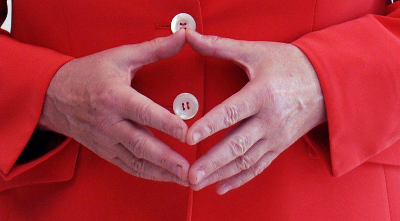 Angela Merkel e o seu gesto característico com as mãos