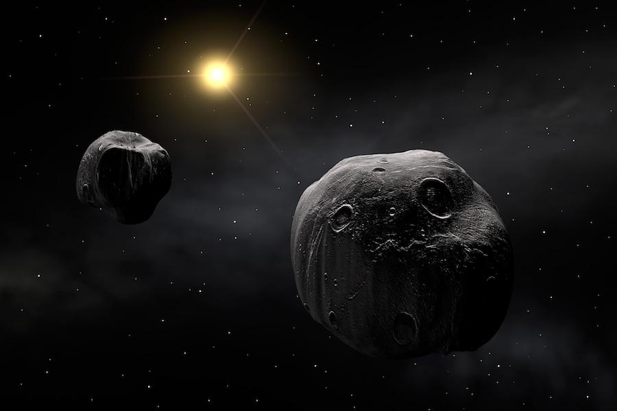 Conceito artístico do asteróide binário Antiope. Cerca de 15% dos asteróides próximos da Terra são binários.