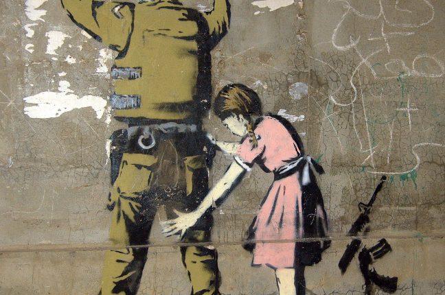 Foto de Pawel Ryszawa, Graffiti de Banksy em Bethlehem
