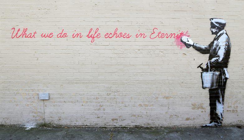 Graffitti de Banksy numa rua de Londres