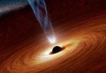 Conceito artístico de um buraco negro supermassivo, com biliões de vezes a massa do nosso Sol, a ejectar um fluxo de partículas energéticas propulsionadas pela rotação do buraco negro.