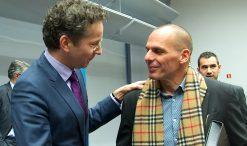 Jeroen Dijsselbloem, presidente do Eurogrupo, com Yanis Varoufakis, ministro das Finanças da Grécia