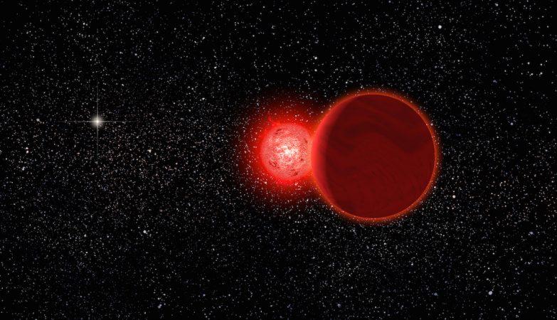 Conceito artístico deuma estrela anã vermelha e da sua companheira anã castanha (em primeiro plano) na sua passagem pelo Sistema Solar, há 70.000 anos. O Sol aparece como a estrela brilhante ao fundo. As estrelas estão agora a 20 anos-luz de distância.