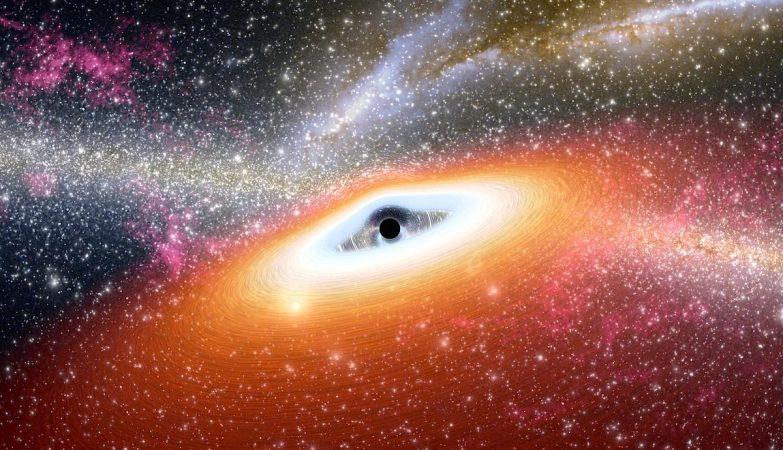 Conceito artístico de um buraco negro supermassivo primitivo, com 13 mil milhões de anos, no coração de uma galáxia rica em estrelas.