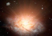 Conceito artístico da galáxia WISE J224607.57-052635.0 - a galáxia mais luminosa do Universo