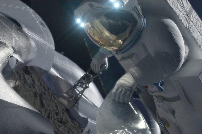 Conceito artístico de um astronauta a recolher amostras de minério de um asteróide