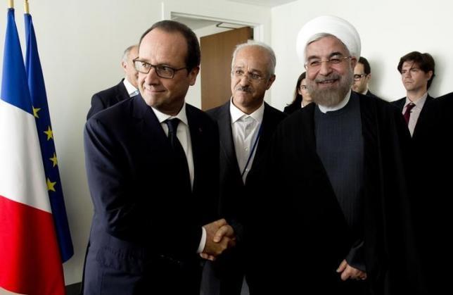 O presidente da França, François Hollande, com o presidente do Irão, Hassan Rohani