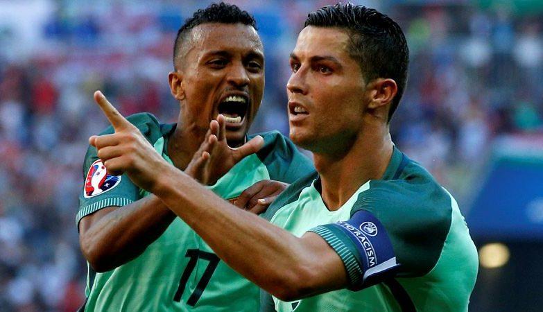 Ronaldo e Nani celebram o 2-2 frente à Hungria