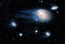 """Impressão de artista do processo """"ram-pressure stripping"""" a retirar o gás das galáxias"""