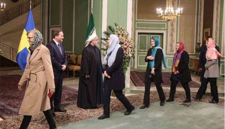 Mulheres do governo da Suécia desfilam com o hijab perante o presidente do Irão, Hassan Rouhani.