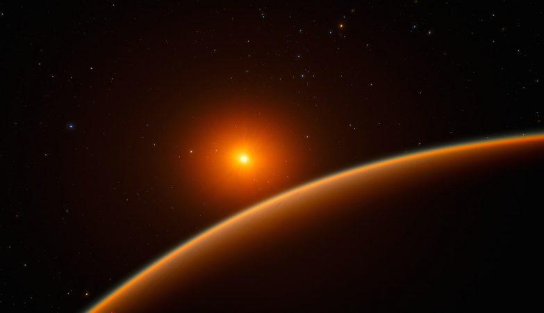 Imagem artística do exoplaneta LHS 1140b, com a sua estrela mãe, uma anã vermelha, no fundo da imagem
