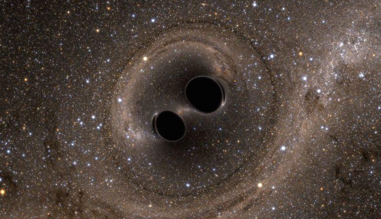 Quando dois buracos negros colidem, formam-se ondas gravitacionais no próprio espaço