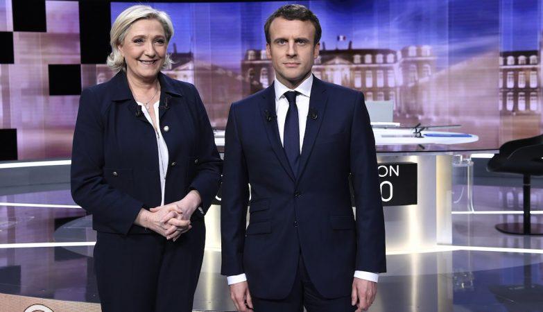Os candidatos Marine Le Pen e Emmanuel Macron no último debate televisivo antes das eleições presidenciais